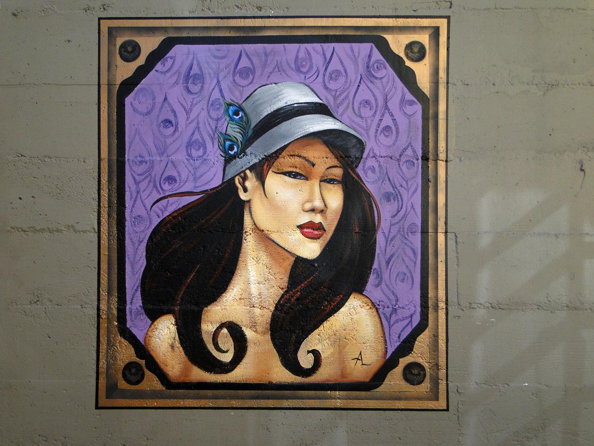 ALynn street art lady outside Goren Hat Co in Soma of San Francisco