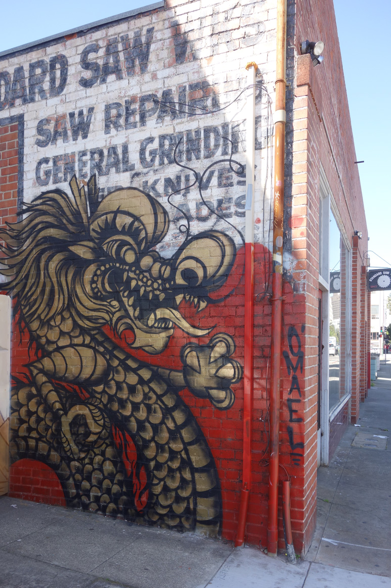 Street art golden dragon in Oakland Chinatown