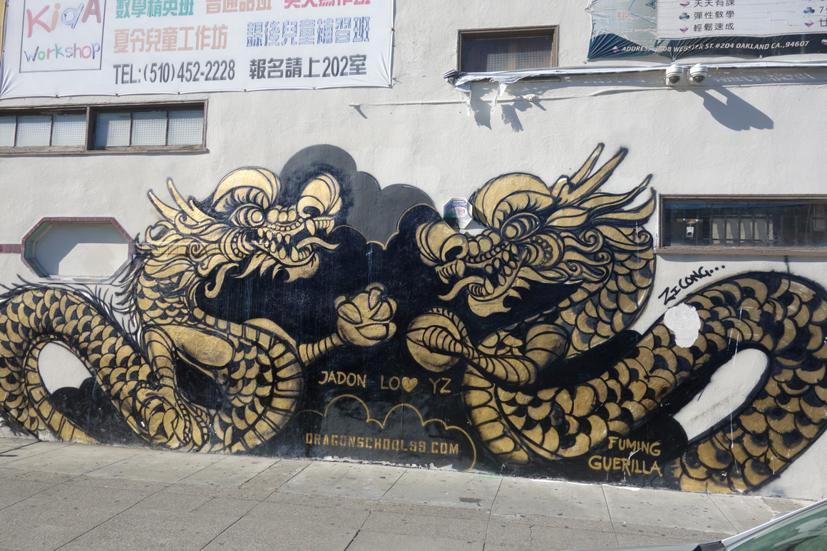 Dragon School street art golden dragons in Oakland Chinatown