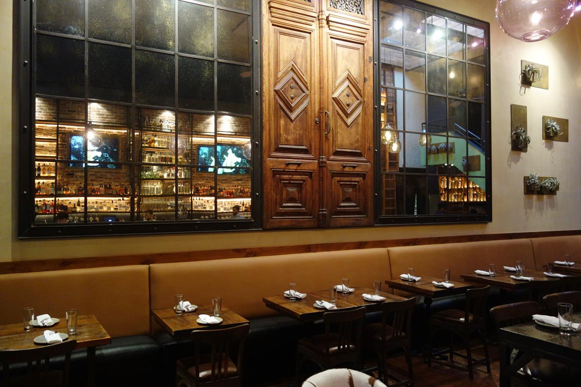 Mezcalito restaurant in San Francisco with Brian Barneclo mural